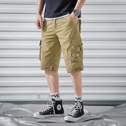 e6b82f173d Pantalones cortos para hombre Casual Multi-bolsillo Longitud de la rodilla  Cremallera suelta Pantalones cortos masculinos Pantalones de carga joggers  ropa ...