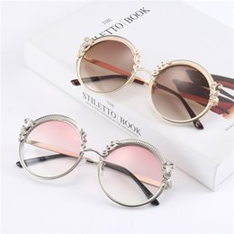 Wholesale New High quality beach sunglasses women Fashion designer classic glasses A round frame of metallic eyeglasses with a pattern