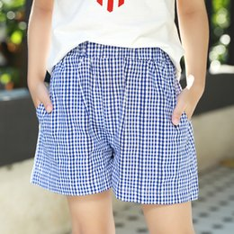 Hottest Girl Short Pants NZ - Girls summer shorts 2018 new Korean children's clothing in the big children's cotton casual wild plaid hot pants