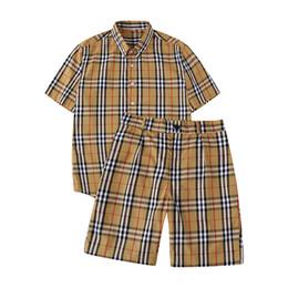 Venta al por mayor de 2019 nueva camiseta de verano para hombres y mujeres para hombre delgado a cuadros de manga corta clásico para hombre y para mujer camiseta pantalones cortos