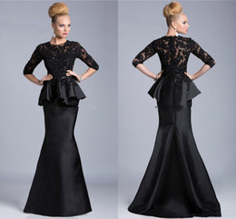 Coral Prom Dress Janique Australia - Janique 2019 Black Mermaid Prom Dresses 2019 Fashion Peplum Formal Evening Gowns Top Lace Applique Beaded illusion Half Sleeves Party Dress