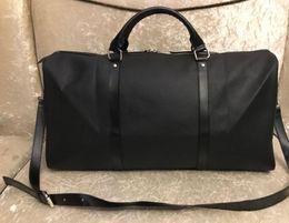 New masculina de moda e bolsa de viagem saco de viagem das mulheres, marca saco de bagagem de designer de grande capacidade 55CM saco de desporto em Promoção