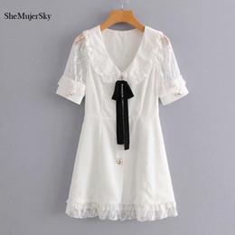 32b39c3d3760 SheMujerSky Women White Lace Spliced Mini Dress Elegant Peter Pan Collar  Bow Tie Summer Dresses 2019 vestidos