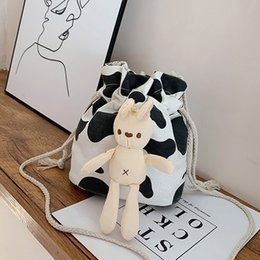 cute puppets UK - Cute Cartoon Puppet Canvas Bag Korean Student Cow Print Drawstring Bag Doll Japanese Harajuku Cow Shoulder Messenger Female