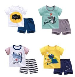 cheap girls summer clothes Canada - cotton Summer baby children soft shorts suit t-shirt toddler boy and girl kids dinosaur cartoon cute clothes cheap stuff for 0-6Y #XHM03304
