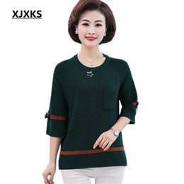 e5d1ab88df1 XJXKS Middle-aged Women Sweater 2019 New Bow Seven-point Sleeve Loose Knit  Casual Plus Size Round Neck Sweater
