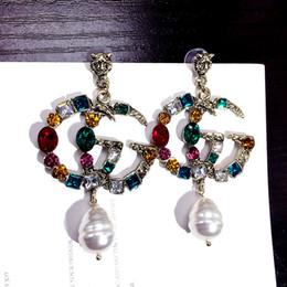 Venta al por mayor de Las mujeres de moda marca de joyería diseñador pendientes originales para Pandora oro y plata perlas cristal para mujer Stud pendiente diverso sty