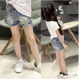 185afca66 2019 Spring And Summer New Girls Denim Shorts Korean Children's Wild Washed  Broken Flash Edge Hot Pants