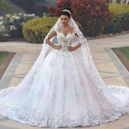 $enCountryForm.capitalKeyWord Australia - Vintage Arabic Illusion O Neck Appliqued Beaded Pearls Cap Sleeve Sheer Back Puffy Ball Gowns Wedding Dresses 2018 Custom Made Bridal Gowns