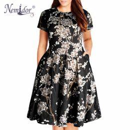 37667ad2779 Nemidor Women Casual O-neck Short Sleeve 50s Party A-line Dress Vintage  Print Midi Plus Size 8xl 9xl Swing Dress With Pockets Y190415