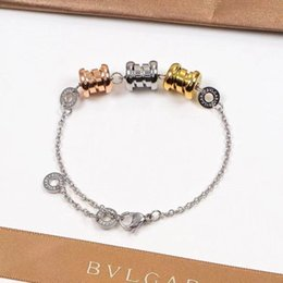 titanium bracelets Australia - New fashion men and women in 2020 three ring three color spring titanium steel bracelets, couples decorative bracelets wholesale