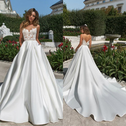 white winter church dress Australia - White Satin Church Wedding Dresses 2020 Sexy Backless Sheer V Neck Lace Appliqued Long Bridal Gowns With Pockets