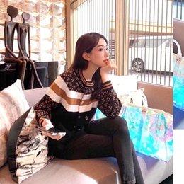 Wholesale woollen sweaters women for sale – oversize Fall winter European station fashion and elegant jacquard crew neck women s sweater retro print women s sweater woollen coat