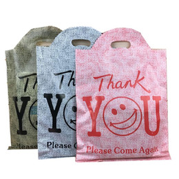 """$enCountryForm.capitalKeyWord Australia - Wholesale 50Pcs lot """"thank you"""" Printed PE Store Jewelry Packaging Hand Bag Smiley face Boutique Shopping Cosmetic Gift Carry Bag 25*40CM"""