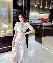 $enCountryForm.capitalKeyWord Australia - Elegant Hollow Out White Lace Dress A-Line 2019 Summer Women Short Sleeve Ruffles Dress V Neck Embroidery Party