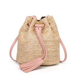 75f329f6f918 Tassel Straw Package New Woven Beach Bag Messenger Lady Fresh Handbag  Crossbody Bag Double tassel busket