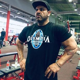 Wholesale OLYMPIA Men Running Tight Short T shirt compression t shirt Male Gym Fitness Bodybuilding jogging Man Tees Tops Brand clothing
