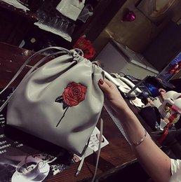 $enCountryForm.capitalKeyWord NZ - Fashion new handbag High quality PU leather Women bag Flower embroidery pumping bucket bag Rose Chain Shoulder Female Bag