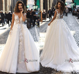 7ba30ff3ee7e 2019 Elegant Cap Sleeves Lace Wedding Dresses A Line Tulle Lace Applique  Sheer Back Bridal Gowns with Detachable Overskirts BC1129