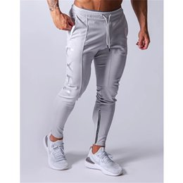 muscle print pants Australia - Sports pants men's jogger fitness sports trousers new fashion printed muscle men's fitness training pants
