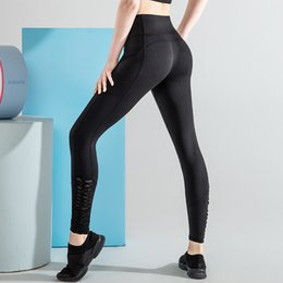Wholesale female bodybuilding clothing resale online - 2020 Money Clothing Female Peach Hip Running Bodybuilding Sports Gao Waist And Hips Yoga Pants Side Pocket Trousers