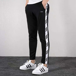 Wholesale strip pants for sale - Group buy Design New Men s Pants Fashion Jogging Hip Hop Stripped Pencil Pant With
