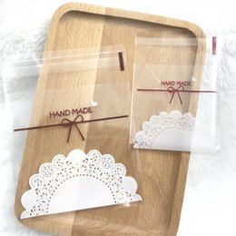 $enCountryForm.capitalKeyWord Australia - 2 sizes 100pcs Plastic Cookie Bags Transparent Lace Bow-knot Cookie Bag Wedding Cake Candy Macaron Packaging Bag
