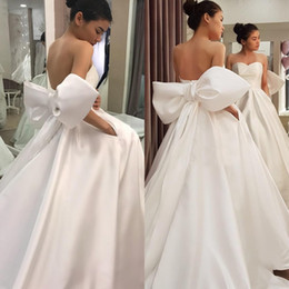 $enCountryForm.capitalKeyWord Australia - Charming A Line Sweetheart Neckline Satin Backless Bridal Gown Plus Size Sweep Train Bow Knot Wedding Dress With Pockets