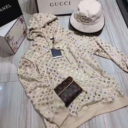 Wholesale Spring 2020 new web celebrity, the same type of radiant bronzing hoodie, loose thin print jacket and blouse