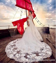 $enCountryForm.capitalKeyWord Canada - A Line White Tulle Beach Off Shoulder Cheap Milla Nova Wedding Dress Bridal Gowns Bling Long Train With Flowers 2019