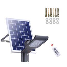 Luce solare a LED SMD ad alta potenza LED Sicurezza di inondazione Luce da giardino IP66 impermeabile Lampada solare a palo per proiettore in Offerta