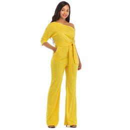 Nueva moda fuera del hombro Jumpsuits elegantes mujeres tallas grandes  mamelucos Womens Jumpsuits manga corta para mujer monos c936a1c64522