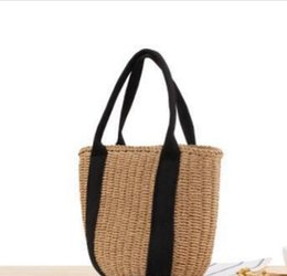 b7b9762a2f Wholesale 2018 Europe and America portable bucket woven bags handcuffs  black ribbon straw bag summer vacation photo Women girls beach bag