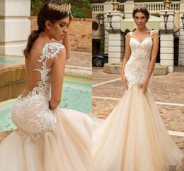 See Through Wedding Dress Crystal Beading UK - Crystal Design Mermaid Wedding Dress Sexy See Through Back Vestido De Novia Champagne Lace 2019 garden Wedding Dresses