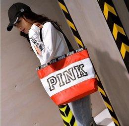 Venta al por mayor de HighWomen Bolsos de color rosa Nuevos bolsos bandolera Superficie de la textura Bolsas de lona Bolsas de compras impermeables de Euramerican Fashion