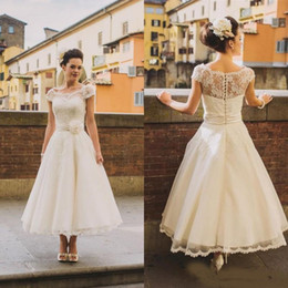 a60b9991acb6 Vintage Scoop Cap Sleeves Tea Length A Line Lace Wedding Dresses 2018  Hand-made Flower Sash Arabic Country Rustic Bride Wedding Gowns