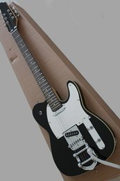 $enCountryForm.capitalKeyWord UK - Factory made black electric guitar and vibrato system, white shield, mahogany range, providing customized service