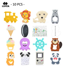 Necklaces Pendants Australia - 10 Pieces  Lot Silicone Baby Teether Penguin Teething Monkey Pendant Raccoon Toy Giraffe Necklace For Silicone Lion Elephant Y19050901