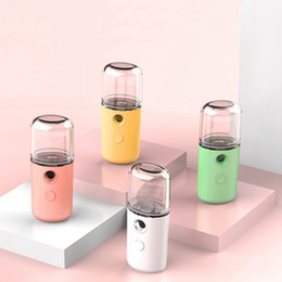 Venta al por mayor de USB Cara Botella del aerosol de carga Nano Vapor facial portable de hidratación de la piel de la cara pulverizador Herramientas de Belleza HHA1379