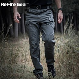 Full Military Gear NZ - IX7 Gear Military Urban Tactical Pants Men Spring Cotton SWAT Army Cargo Pants Casual EDC Pockets Police Soldier Combat Trouser 1741
