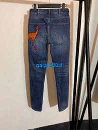 $enCountryForm.capitalKeyWord Australia - high end women girls denim pant jeans casual deer patch skinny slim pencil pants capris top quality paris fashion design luxury trousers