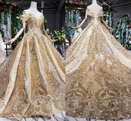 Wholesale Luxury Gold Sparkly Sequined Ball Gown Wedding Dress Dubai Arabic Lace Appliqued Beaded Off Shoulder Corset Back Princess Tssels Bridal Gown