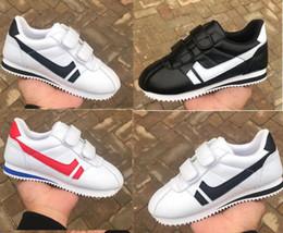Vente en gros Taille 25-45 Haute Qualité Womens Mens Casual Chaussures Jogging Enfants Casual Toile Chaussure Design Classique Bébé Enfants Sports Sneakers pour hommes