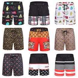 fashion swimwear prints NZ - men's summer fashion bañador Shorts New Designer luxury printed board beach pants men's designer swimwear print pantaloncini HMDK22
