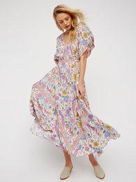 b14d07237b8 Femmes Maxi Boho robe oiseau imprimé floral été profond col en V gland  manches chauve-