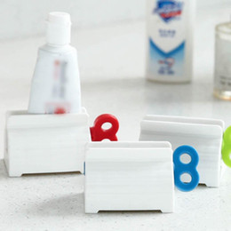 tube squeezers plastic NZ - Toothpaste Tube Squeezer Stand Hanging Holder Toothpaste Cleanser Extruder Clamps Toothpaste Clip Rolling Toothpastes Dispenser EEA1340