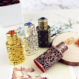 indian candles Australia - 3ml Antiqued Metal Perfume Bottle Arab Style Alloy Hollow out Essential Oils Bottle Middle East Glass Dropper Bottle