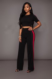ladies sexy white pant suit NZ - 2018 New Fashion 2 Piece Clothing Set Women White and Black Crop Top And Pants Suit ladies Sexy Two Piece Tracksuit TS661 T200605