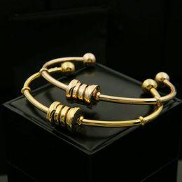 Steel Gold 18k NZ - 316L titanium steel spring lobster clasp bangles&bracelet High quality boutique 18K rose gold gold silver couple bangles