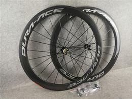 Vente en gros DURA ACE Route Carbone Roue à pneu tubulaire 50mm 60mm 700C Wheelset brillant mat 3k / ud C8 roulement en céramique